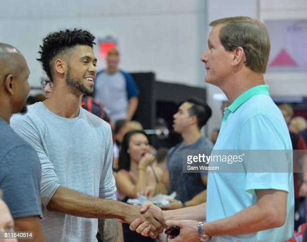 Tyler Dorsey of the Atlanta Hawks greets his former college head coach Dana Altman of the Oregon Ducks before a game between the Sacramento Kings and...