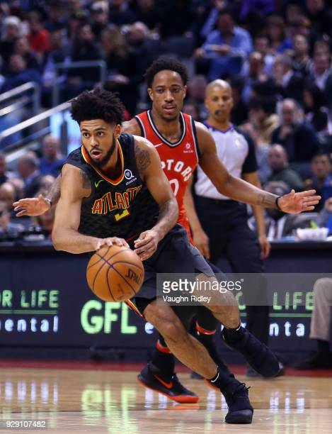 Tyler Dorsey of the Atlanta Hawks dribbles the ball as DeMar DeRozan of the Toronto Raptors defends during the second half of an NBA game at Air...