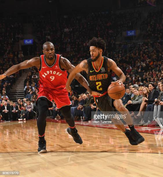 Tyler Dorsey of the Atlanta Hawks handles the ball against Serge Ibaka of the Toronto Raptors on March 6 2018 at the Air Canada Centre in Toronto...