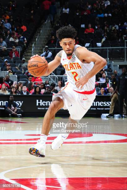 Tyler Dorsey of the Atlanta Hawks handles the ball against the Charlotte Hornets on March 15 2018 at Philips Arena in Atlanta Georgia NOTE TO USER...
