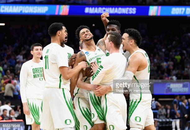 Tyler Dorsey of the Oregon Ducks celebrates with teammates after defeating the Rhode Island Rams 7572 during the second round of the 2017 NCAA Men's...