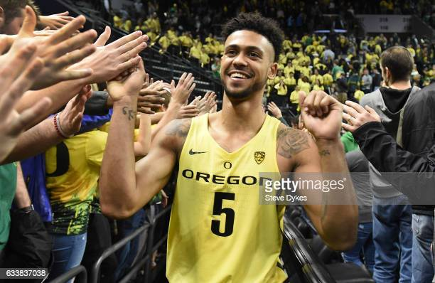 Tyler Dorsey of the Oregon Ducks celebrates with the students after they defeated the fifth ranked Arizona Wildcats 8558 at Matthew Knight Arena on...