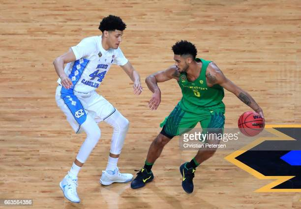 Tyler Dorsey of the Oregon Ducks handles the ball against Justin Jackson of the North Carolina Tar Heels in the first half during the 2017 NCAA Men's...