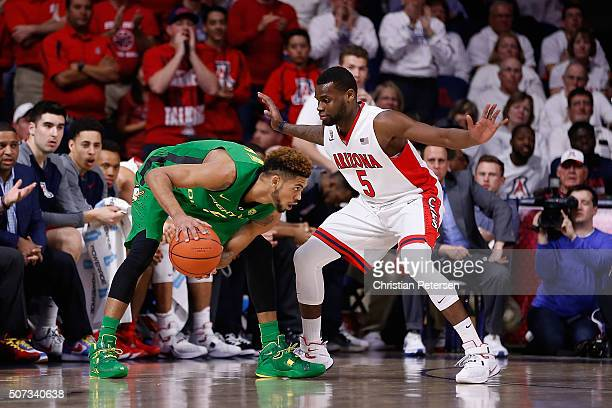 Tyler Dorsey of the Oregon Ducks handles the ball under pressure from Kadeem Allen of the Arizona Wildcats during the first half of the college...
