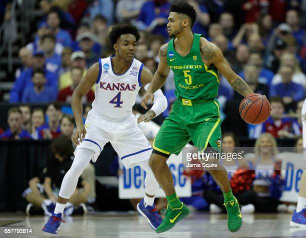 Tyler Dorsey of the Oregon Ducks is defended by Devonte' Graham of the Kansas Jayhawks during the 2017 NCAA Men's Basketball Tournament Midwest...