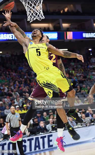 Tyler Dorsey of the Oregon Ducks is fouled as he shoots the ball against Taylor Bessick of the Iona Gaels in the first half during the first round of...