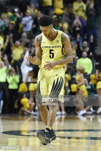 Tyler Dorsey of the Oregon Ducks looks at his hand as he celebrates after hitting a shot during the first half of the game against the Arizona...