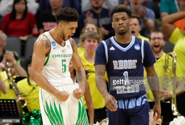 Tyler Dorsey of the Oregon Ducks reacts as Jarvis Garrett of the Rhode Island Rams watches on during the second round of the 2017 NCAA Men's...