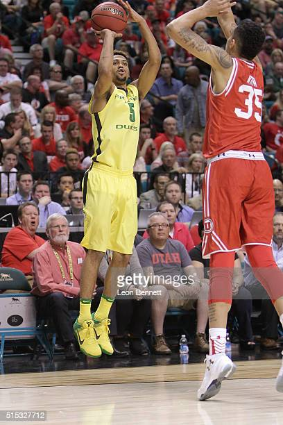 Tyler Dorsey of the Oregon Ducks shoots over a Utah Utes defender during the championship game of the Pac12 Basketball Tournament at MGM Grand Garden...