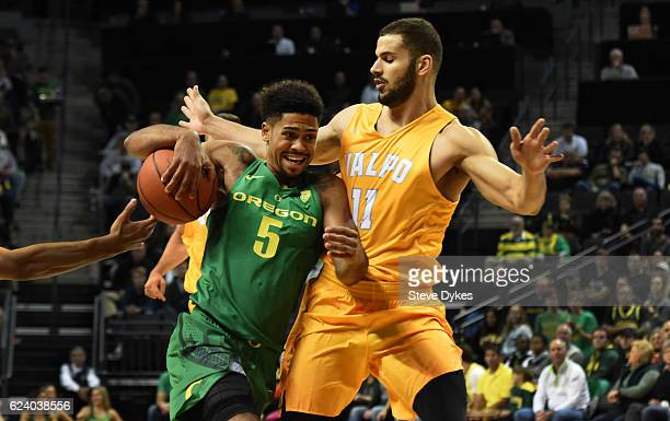Tyler Dorsey of the Oregon Ducksdrives to the basket on Shane Hammink of the Valparaiso Crusadersin the first half of the game at Matthew Knight...