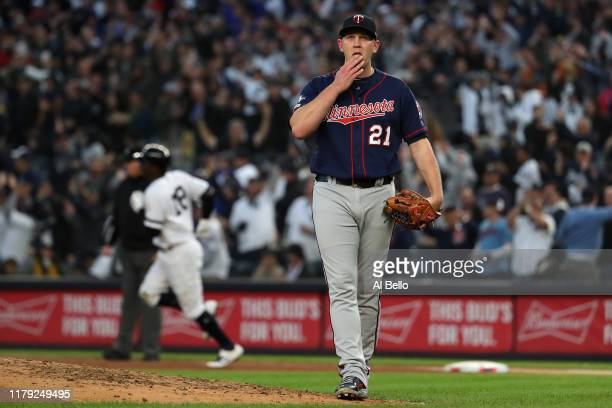 Tyler Duffey of the Minnesota Twins reacts after allowing a grand slam home run to Didi Gregorius of the New York Yankees in the third inning in game...