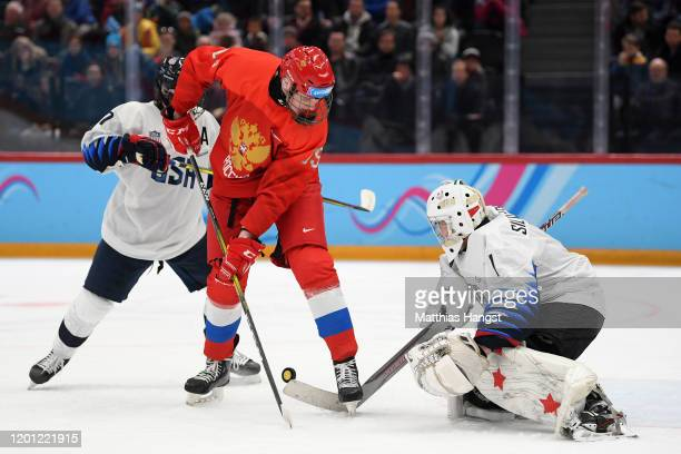 Tyler Duke of USA Kirill Dolzhenkov of Russia and Dylan Silverstein of USA battle for the puck during the Men's 6Team Ice Hockey Tournament Finals...
