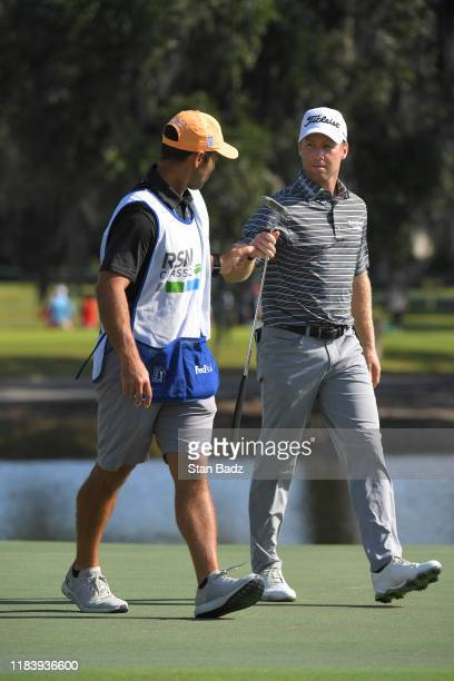 Tyler Duncan bumps fist with his caddie on the second green during the second round of The RSM Classic at Sea Island Resort Seaside Course on...