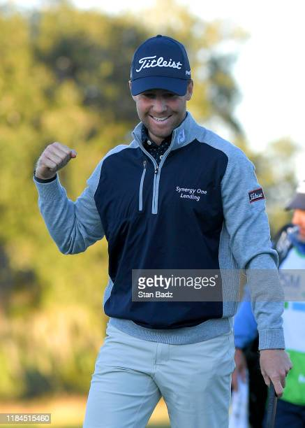 Tyler Duncan celebrates on the 18th green after winning the second playoff hole against Webb Simpson during the final round of The RSM Classic at Sea...