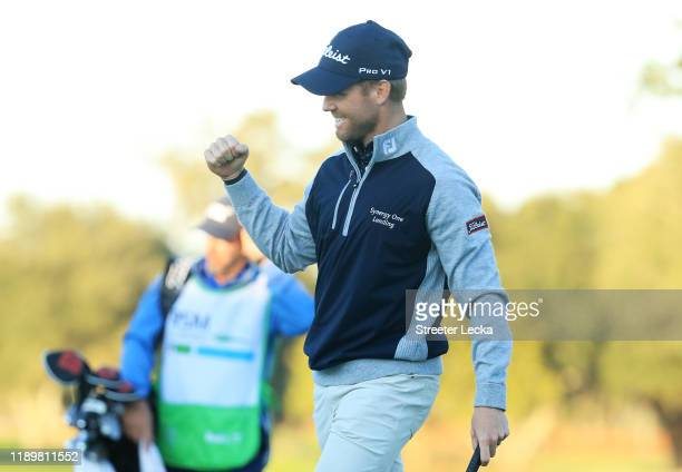 Tyler Duncan of the United States celebrates on the 18th green after winning the second playoff hole against Webb Simpson of the United States in the...