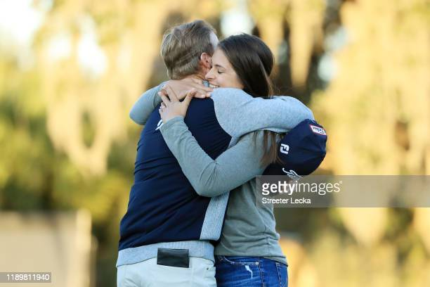 Tyler Duncan of the United States celebrates with his wife Maria on the 18th green after winning the second playoff hole against Webb Simpson of the...