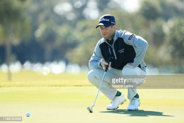 Tyler Duncan of the United States lines up a putt on the first green during the final round of the RSM Classic on the Seaside course at Sea Island...