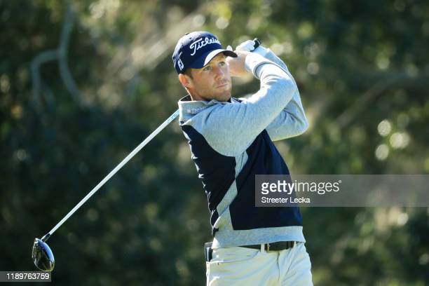 Tyler Duncan of the United States plays his shot from the second tee during the final round of the RSM Classic on the Seaside course at Sea Island...