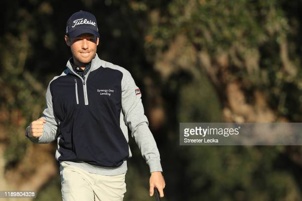 Tyler Duncan of the United States reacts to his birdie on the 18th green during the final round of the RSM Classic on the Seaside course at Sea...