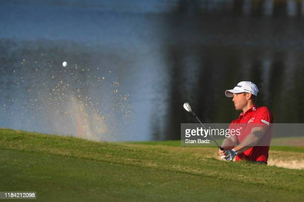 Tyler Duncan plays a bunker shot on the 18th hole during the third round of The RSM Classic at Sea Island Resort Seaside Course on November 23 2019...