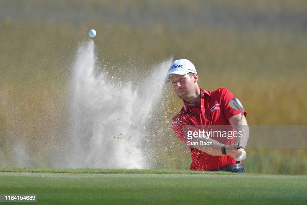 Tyler Duncan plays a bunker shot on the fourth hole during the third round of The RSM Classic at Sea Island Resort Seaside Course on November 23 2019...
