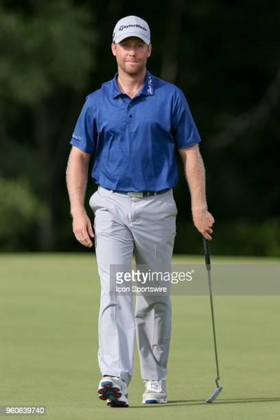 Tyler Duncan walks off the 17th green after making birdie during the final round of the 50th annual ATT Byron Nelson on May 20 2018 at Trinity Forest...