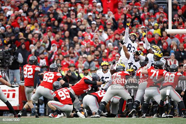 Tyler Durbin of the Ohio State Buckeyes kicks a field goal to force overtime against the Michigan Wolverines at Ohio Stadium on November 26 2016 in...