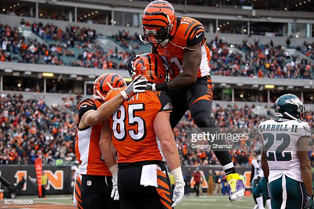 Tyler Eifert is congratulated by Alex Erickson and Brandon LaFell all of the Cincinnati Bengals after scoring a touchdown during the second quarter...