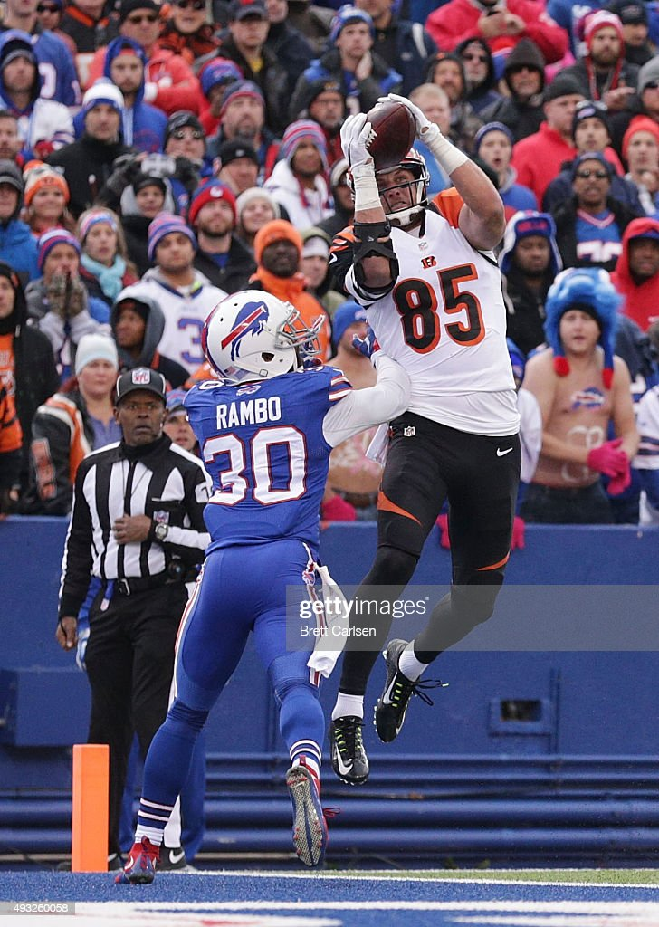 Tyler Eifert #85 of the Cincinnati Bengals catches a touchdown pass in front of Bacarri Rambo #30 of the Buffalo Bills during the second half at Ralph Wilson Stadium on October 18, 2015 in Orchard Park, New York.