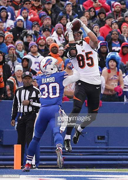 Tyler Eifert of the Cincinnati Bengals catches a touchdown pass in front of Bacarri Rambo of the Buffalo Bills during the second half at Ralph Wilson...
