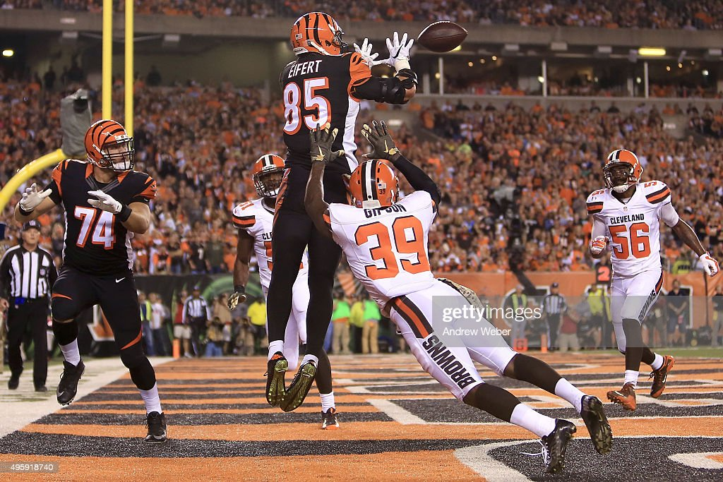 Tyler Eifert #85 of the Cincinnati Bengals catches a touchdown pass over Tashaun Gipson #39 of the Cleveland Browns during the second quarter at Paul Brown Stadium on November 5, 2015 in Cincinnati, Ohio.