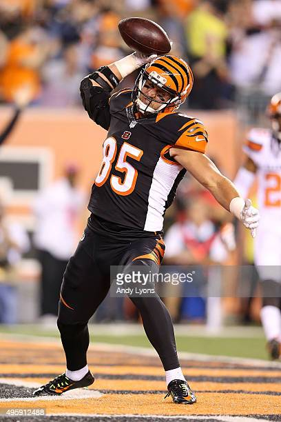 Tyler Eifert of the Cincinnati Bengals celebrates after scoring a touchdown during the first quarter of the game against the Cleveland Browns at Paul...