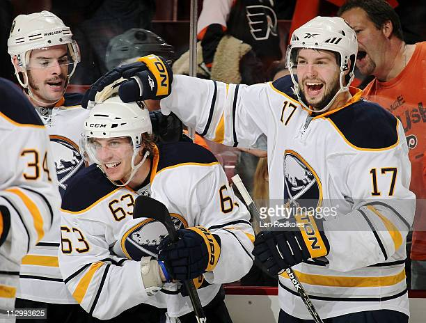 Tyler Ennis and MarcAndre Gragnani of the Buffalo Sabres celebrate Ennis's gamewinning goal in overtime against the Philadelphia Flyers in Game Five...