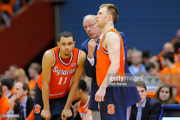 Tyler Ennis head coach Jim Boeheim and Trevor Cooney of the Syracuse Orange talk against the Boston College Eagles during the second half at the...