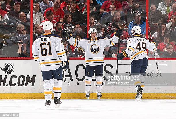 Tyler Ennis of the Buffalo Sabres celebrates his first period goal against the Ottawa Senators with teammates Andre Benoit and Jerry D'Amigo at...