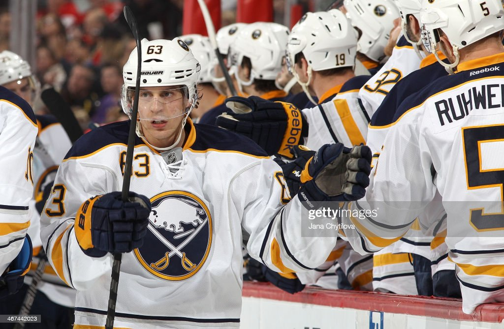 Tyler Ennis #63 of the Buffalo Sabres celebrates his third period goal against the Ottawa Senators with team mate Chad Ruhwedel #5 during an NHL game at Canadian Tire Centre on February 6, 2014 in Ottawa, Ontario, Canada.