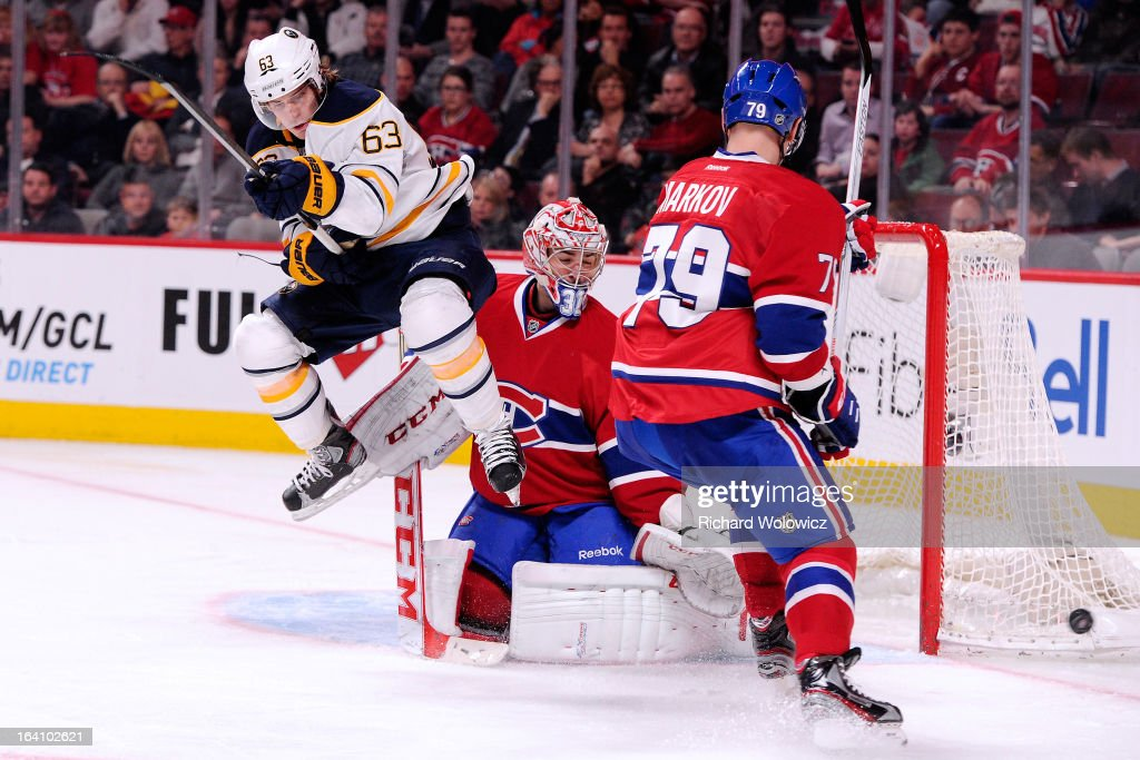 Tyler Ennis #63 of the Buffalo Sabres jumps to screen Carey Price #31 of the Montreal Canadiens during the NHL game at the Bell Centre on March 19, 2013 in Montreal, Quebec, Canada. The Sabres defeated the Canadiens 3-2 in overtime.