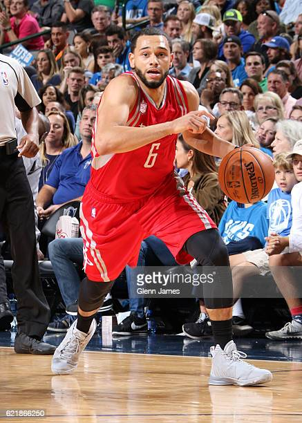 Tyler Ennis of the Houston Rockets handles the ball against the Dallas Mavericks on October 28 2016 at the American Airlines Center in Dallas Texas...