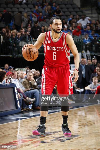 Tyler Ennis of the Houston Rockets handles the ball against the Dallas Mavericks on December 27 2016 at the American Airlines Center in Dallas Texas...