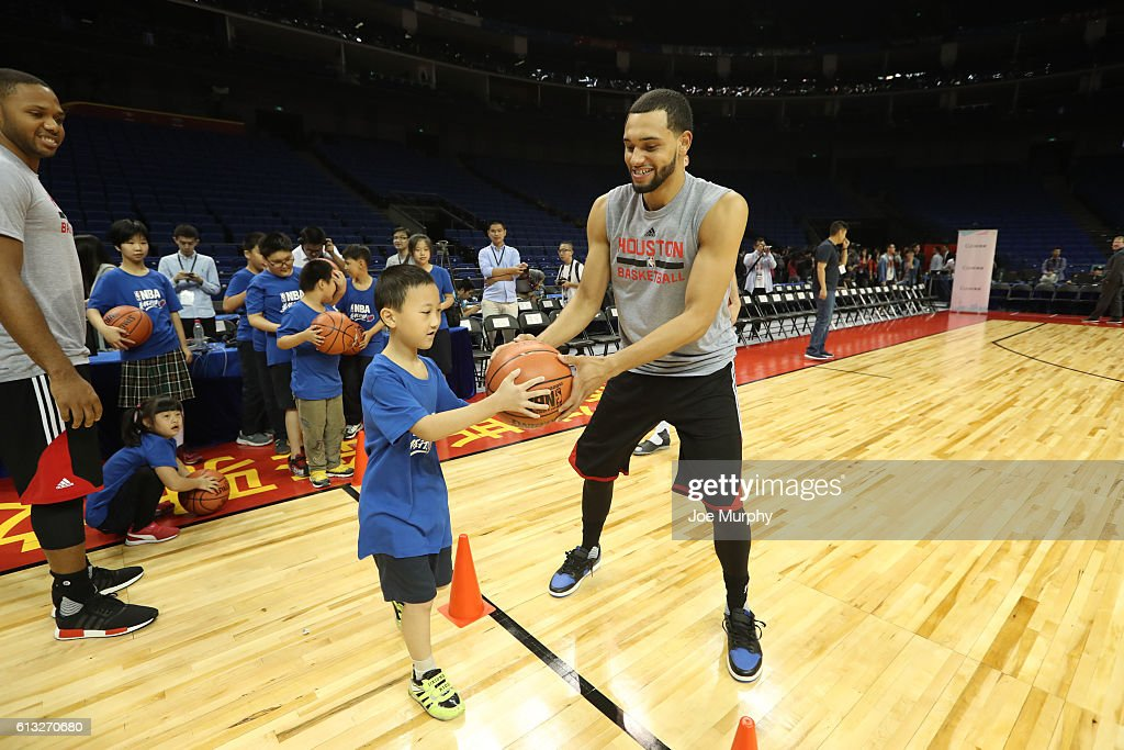 Tyler Ennis of the Houston Rockets interacts with a participant during the Special Olympics NBA Cares Clinic as part of the 2016 Global Games - China at Mercedes Benz Arena on October 8, 2016 in Shanghai, China.
