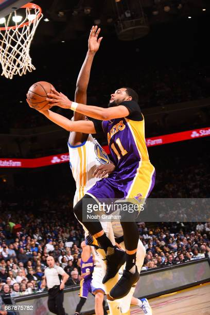 Tyler Ennis of the Los Angeles Lakers goes to the basket against the Golden State Warriors on April 12 2017 at ORACLE Arena in Oakland California...