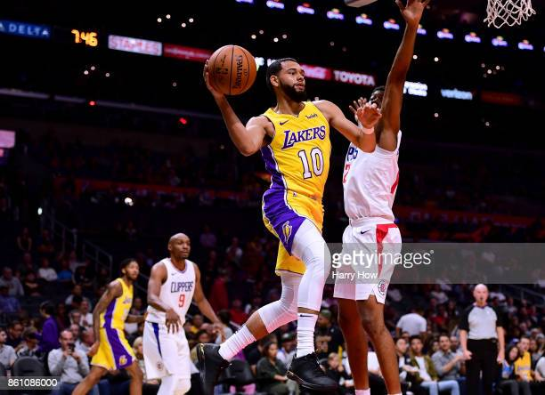 Tyler Ennis of the Los Angeles Lakers looks to pass around Sam Dekker of the LA Clippers during the first half at Staples Center on October 10 2017...