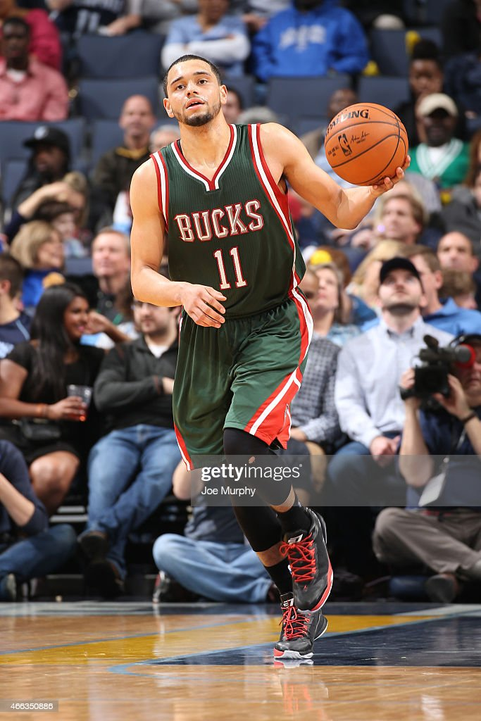 Tyler Ennis #11 of the Milwaukee Bucks brings the ball up court against the Memphis Grizzlies on March 14, 2015 at FedExForum in Memphis, Tennessee.