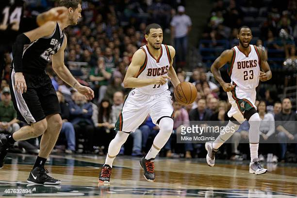 Tyler Ennis of the Milwaukee Bucks dribbles the basketball up the court during the game against the San Antonio Spurs at BMO Harris Bradley Center on...