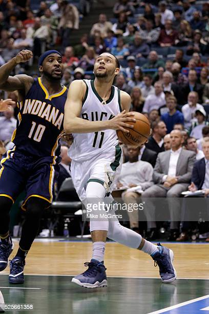 Tyler Ennis of the Milwaukee Bucks drives to the hoop during the game against he Indiana Pacers at BMO Harris Bradley Center on April 13 2016 in...