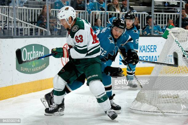 Tyler Ennis of the Minnesota Wild and Kevin Labanc of the San Jose Sharks battle behind the net at SAP Center on April 7 2018 in San Jose California