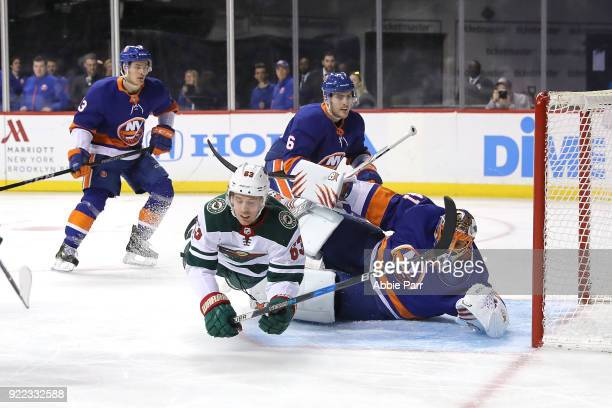 Tyler Ennis of the Minnesota Wild collides with Jaroslav Halak of the New York Islanders in the first period during their game at Barclays Center on...
