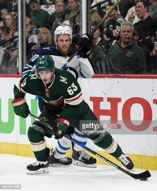 Tyler Ennis of the Minnesota Wild controls the puck against Joe Morrow of the Winnipeg Jets during the second period in Game Four of the Western...