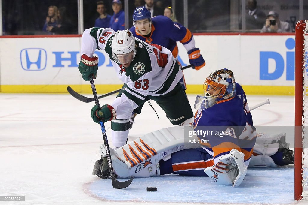 Tyler Ennis #63 of the Minnesota Wild takes a shot against Jaroslav Halak #41 of the New York Islanders in the first period during their game at Barclays Center on February 19, 2018 in the Brooklyn borough of New York City.