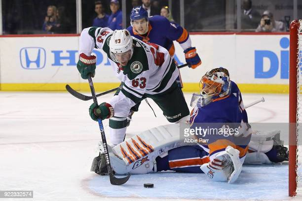Tyler Ennis of the Minnesota Wild takes a shot against Jaroslav Halak of the New York Islanders in the first period during their game at Barclays...